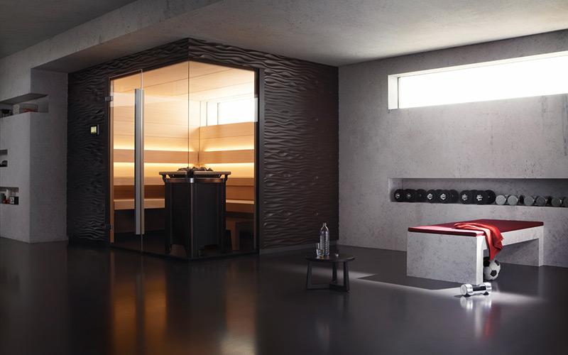 Minimalistická sauna Klafs Shape s nepřímým osvětlením a designovým obložením